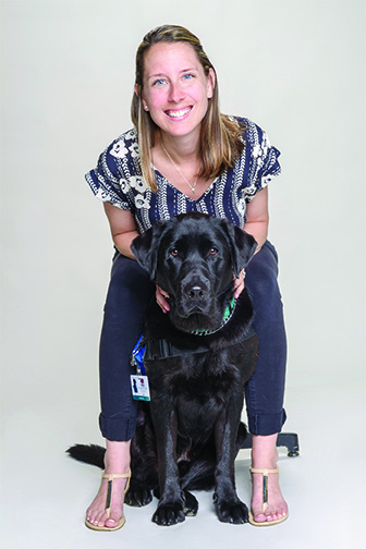 Photo of Facility Service Dog Elvis with trainer