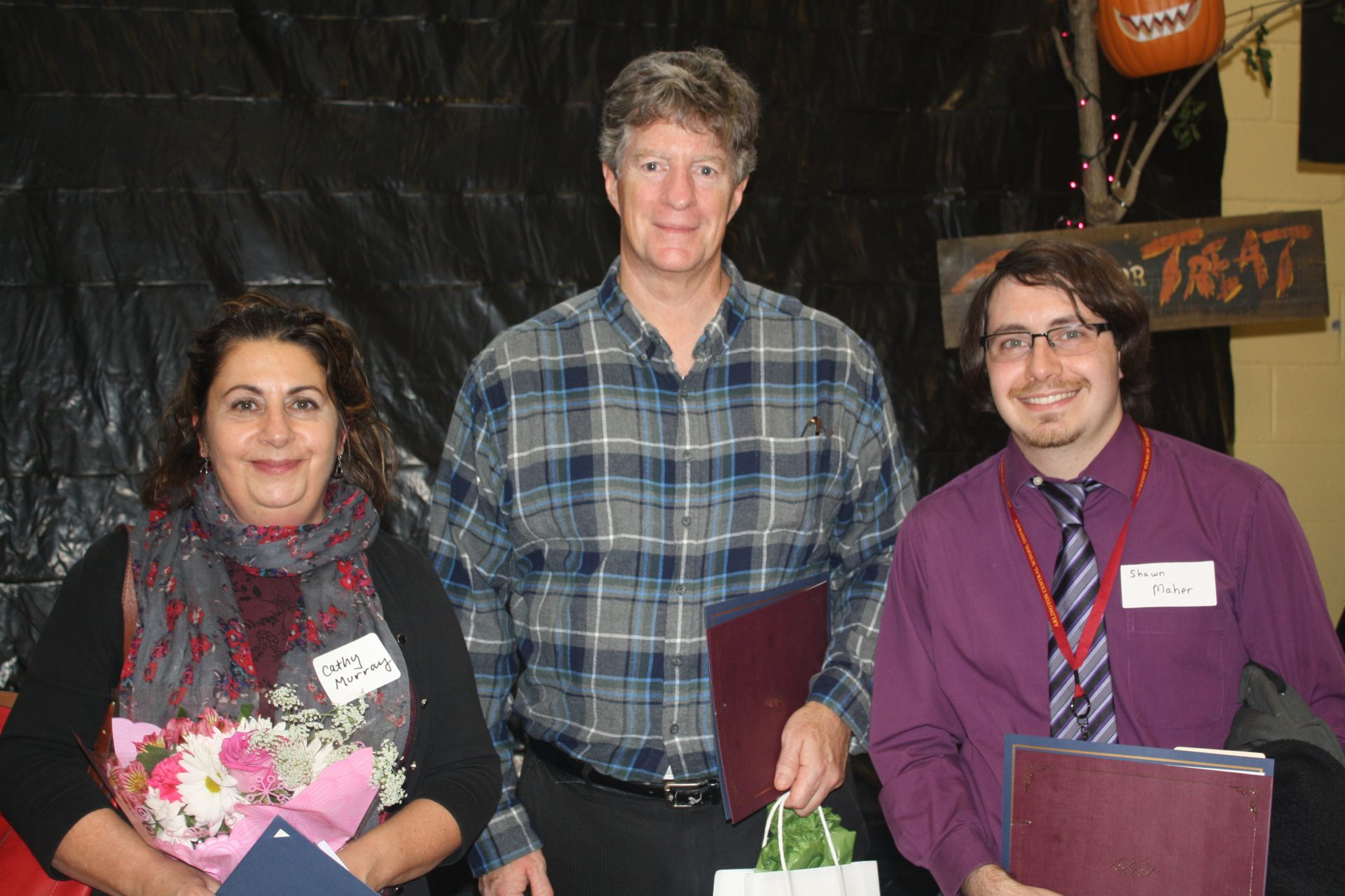 photo of three teachers with certificates