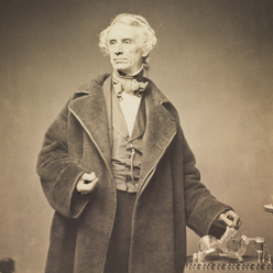 photo of Samuel Morse with his Recorder by Brady, 1857