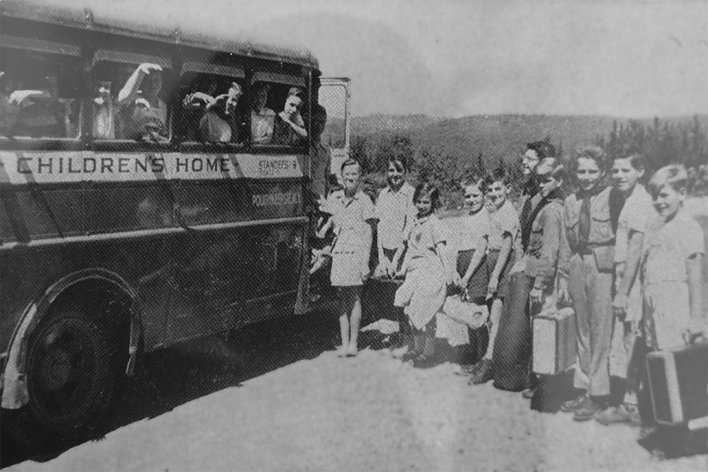 vintage photo of kids getting on the Children's Home bus