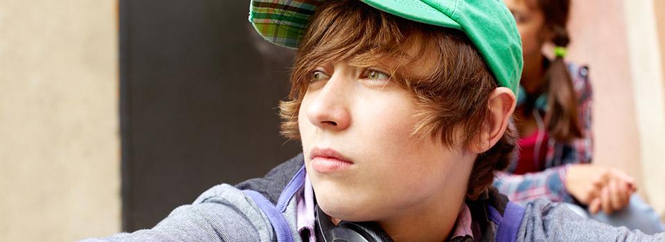 photo of teen boy looking thoughtful