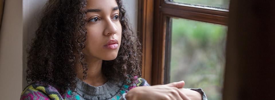 photo of teen girl looking thoughtful
