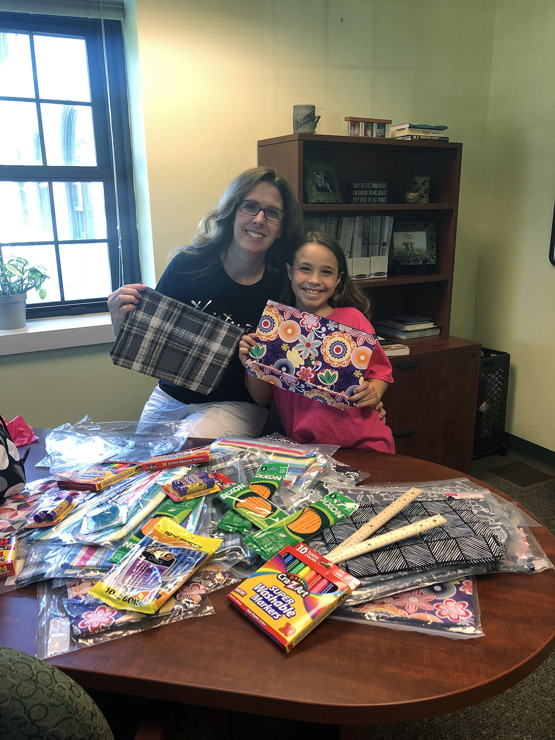 photo of mom and daughter with donated school supplies