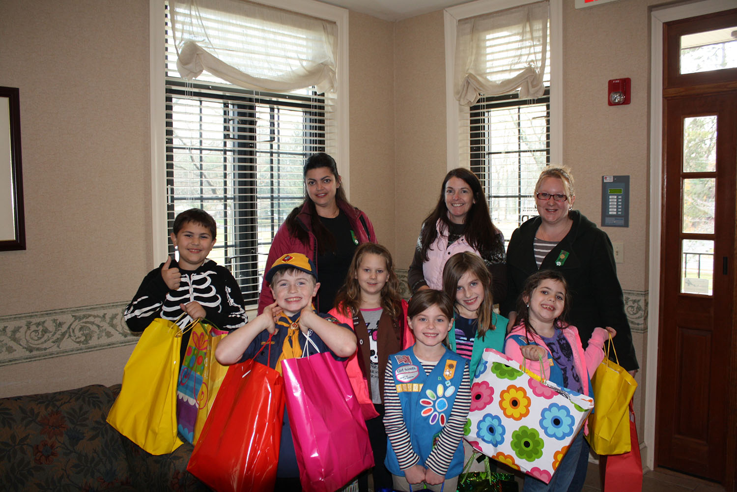 photo of young boy and girl scouts with donations