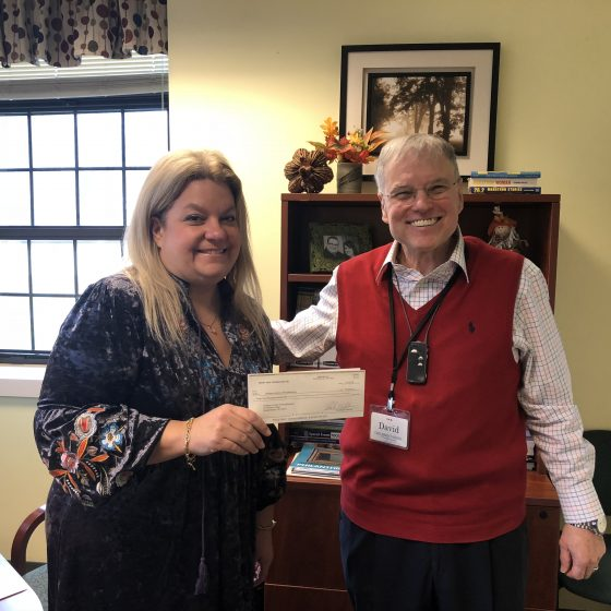 photo of Dr. Crenshaw accepting fundraising check