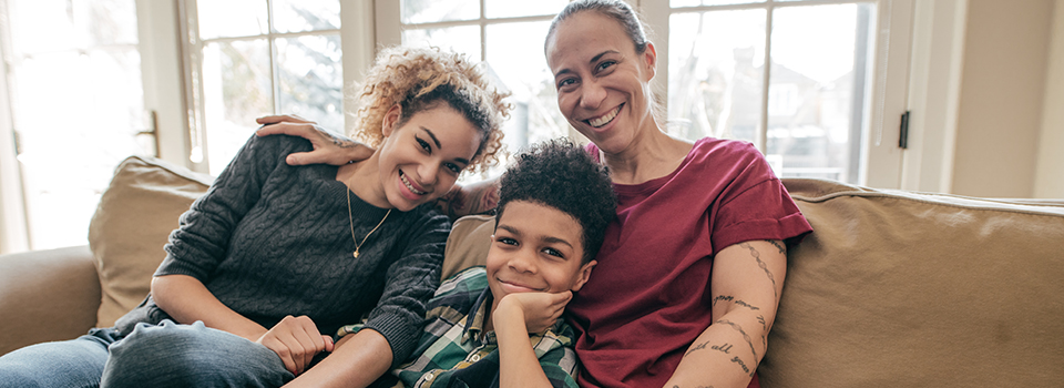 photo of mom with her son and daughter sitting on couch